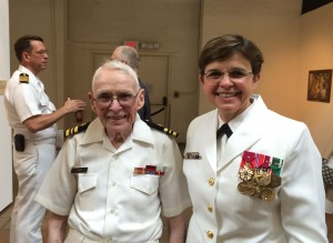 Rear Admiral Margaret Grun Kibben '82 poses with her father, a fellow naval officer, at the Change of Office Ceremony at the Washington Navy Yard on August 1, 2014.