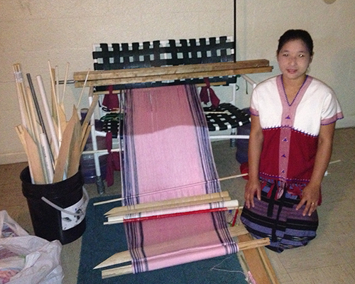 Yay Bwe with her loom