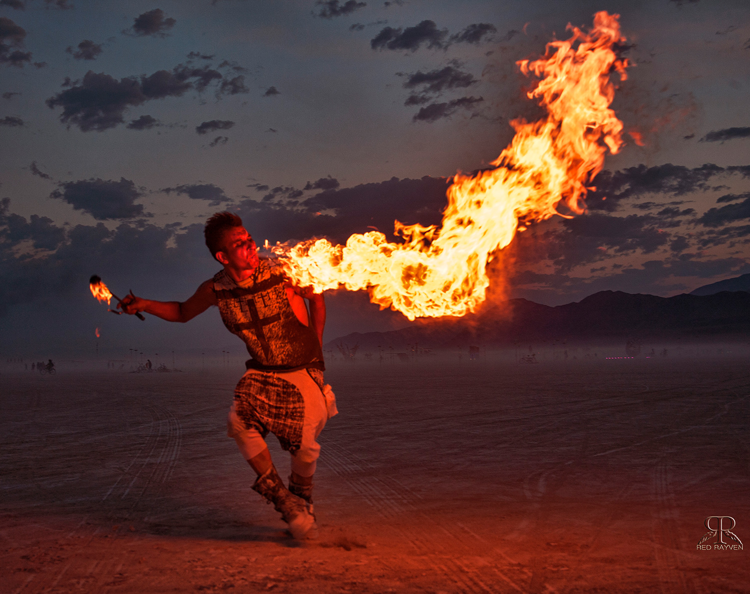 A man uses fire for art at Burning Man