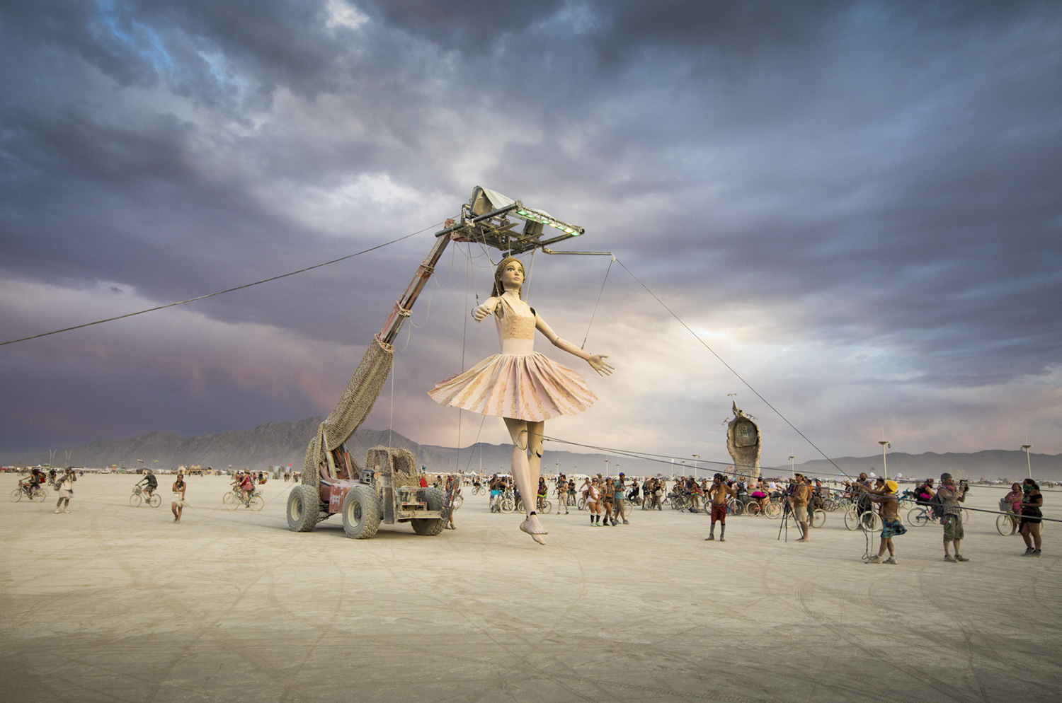 A sculpture is lifted at Burning Man