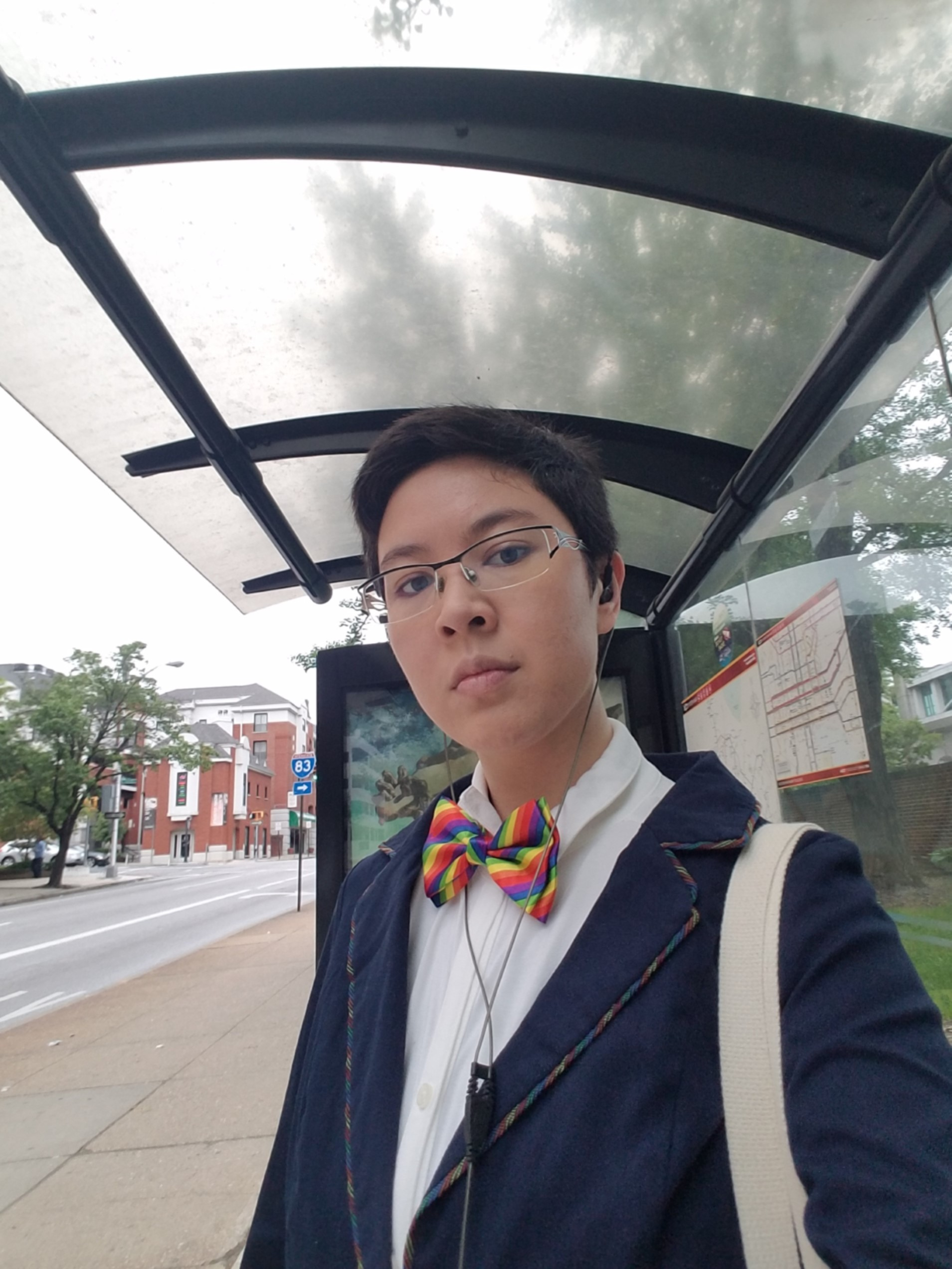 Student takes selfie at bus stop